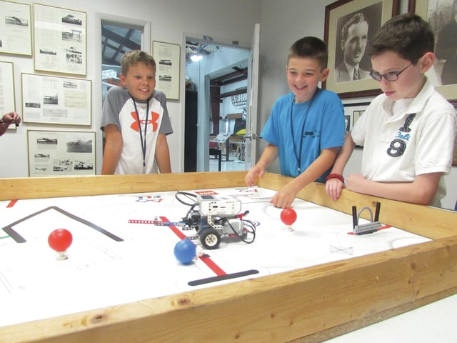 From left, Brock Thiesing, 11, Owen Master, 10, and Carter Robbins, 11, watch as their LEGO robot performs on a playing field at WACO Historical Society's annual robotics camp. More than 18 students ages 10-13 attended the camp last week.