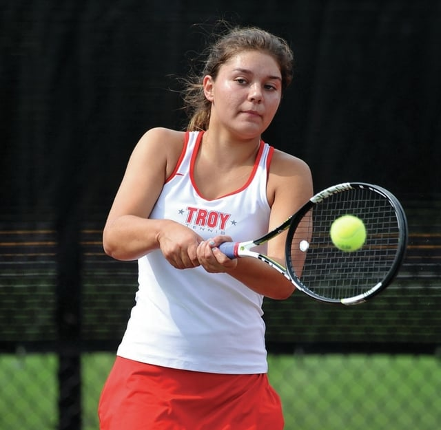 Photo courtesy Lee Woolery/Speedshot Photo Troy's Hannah Essick hits a backhand during a match at first singles against Milton-Union Monday.