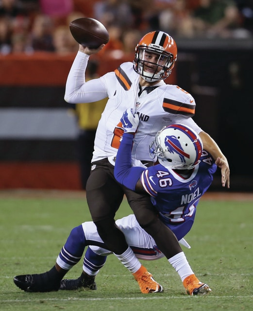 Ron Schwane/AP Buffalo Bills cornerback Merrill Noel (46) sacks Cleveland Browns quarterback Johnny Manziel during the third quarter of an NFL game Thursday in Cleveland.