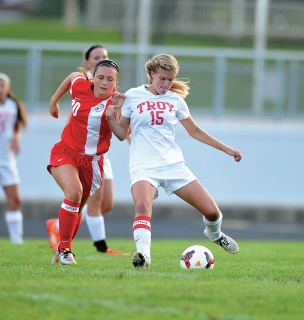 Photo courtesy Lee Woolery/Speedshot Photo Troy's Bailey Dornbusch (15) plays the ball up the field as Tippecanoe's Lexi Blair (10) closes in Saturday at Troy Memorial Stadium.