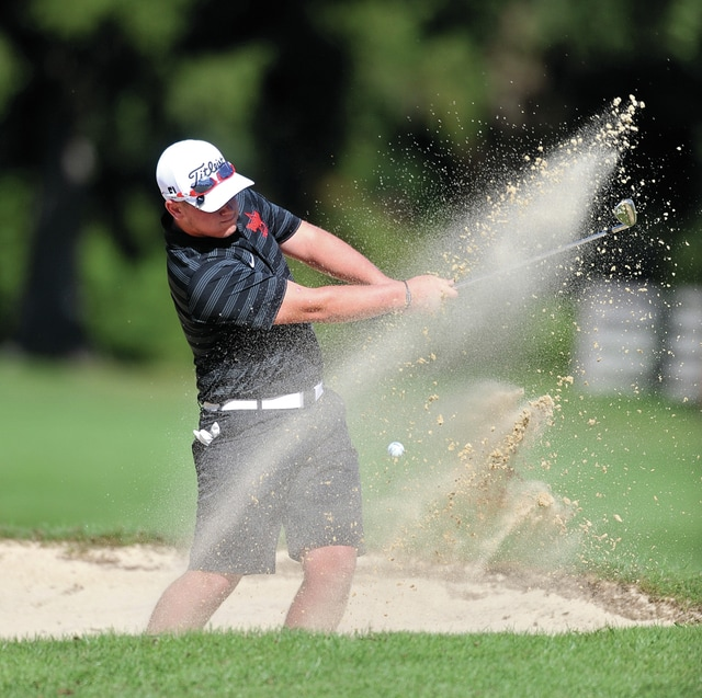Photo courtesy Lee Woolery/Speedshot Photo Troy's Tyler Lambert hits out of a bunker against Centerville at Troy Country Club Monday.