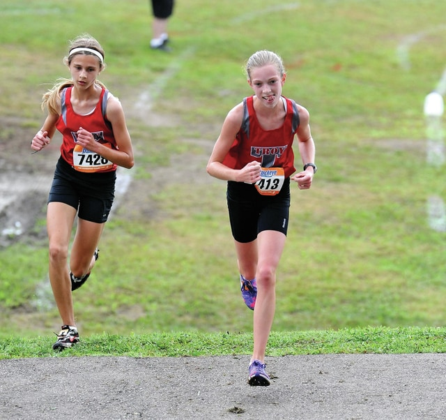 Photo Courtesy of Lee Woolery/Speedshot Photo State qualifiers Emma Shigley (left) and Morgan Gigandet both return for the Troy girls cross country team this season.