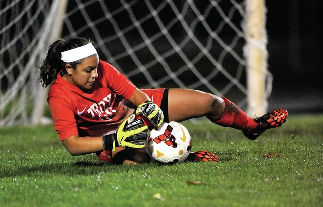 File photo courtesy Lee Woolery/Speedshot Photo Troy's Arianna Garcia makes a save during a game last season.