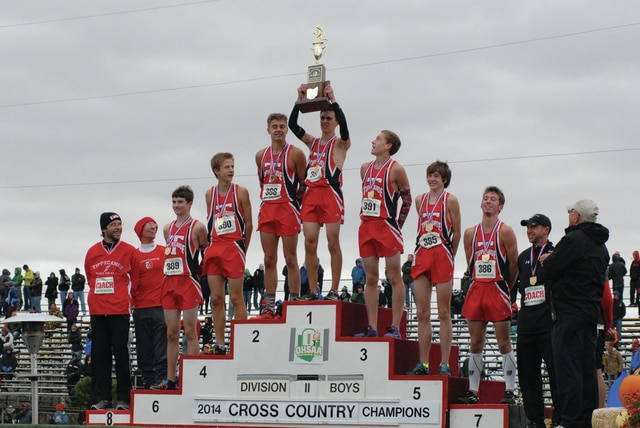 Josh Brown/Troy Daily News file The Tippecanoe boys cross country team celebrates the school's first-ever team state championship last year at National Trail Raceway in Hebron.