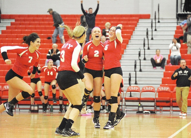 Anthony Weber/Troy Daily News file Troy's volleyball team celebrates a point in a GWOC Tournament victory over Beavercreek. With this being the tournament's final season, the Trojans have set a goal to win it.