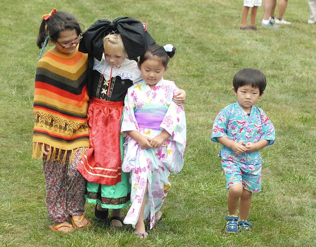 Anthony Weber | Troy Daily News Ale Ullmer, representing Peru, Gabrielle Rounds, representing France, Hasuna Yokoyama, representing Japan, and her brother, Yahiro, walk in unity during the 2015 Festival of Nations Saturday on the levee in Troy.