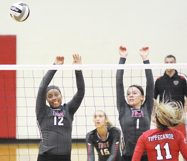 Anthony Weber/Troy Daily News Troy's Drezanee Smith (12) and Camryn Moeller (1) go up for a block as teammate Katie DeMeo (15) backs them up during Tuesday night's win over Tippecanoe.