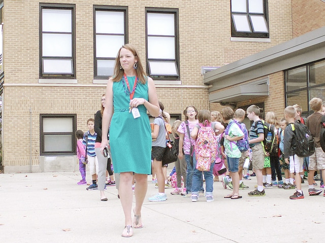 Anthony Weber | Troy Daily News Concord Elementary School Assistant Principal Joyce Koopman assists parents during drop-off and greets students just before school.