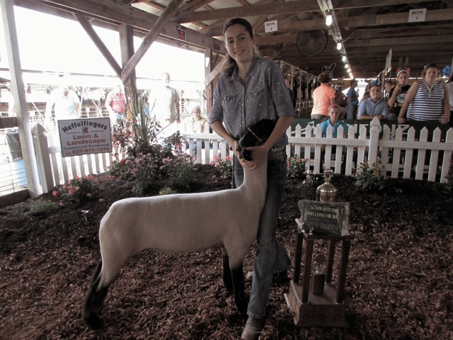 Carly Shell exhibits the Grand Champion Born and Raised market lamb on Tuesday.