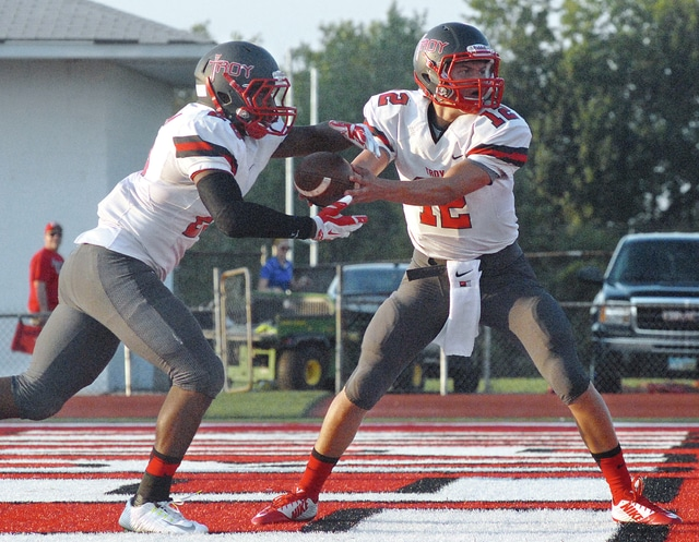 Anthony Weber | Troy Daily News Troy's Elijah Pearson (left) takes a handoff from quarterback Hayden Kotwica during a game last season.