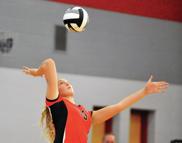 Photo courtesy Lee Woolery/Speedshot Photo Troy's Katie DeMeo goes up for one of her match-high 20 kills Tuesday night during the Trojans five-game victory over Versailles at the Trojan Activities Center.