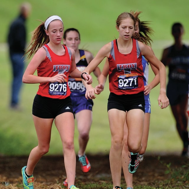 Photo courtesy Lee Woolery/Speedshot Photo Troy's Kate Pence (left) and Megan Myers compete at the Troy Invitational Saturday on the levee. Myers finished second and Pence was third as the Troy girls were second as a team.