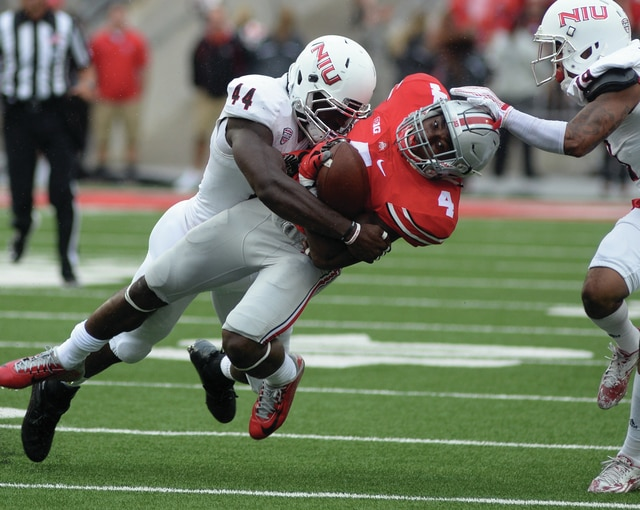 Mike Ullery/Civitas Media Ohio State's Curtis Samuel (4) gets tackled by Northern Illinois defensive end Perez Ford (44) Saturday at Ohio Stadium.