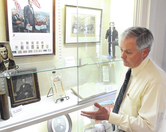 Anthony Weber   Troy Daily News Tom Kleptz discusses a President Lincoln display courtesy of the Kleptz Family Thursday at the Troy-Hayner Cultural Center in Troy. The collection which includes campaign buttons, the first edition Lincoln biography and the 1865 complete transcript of the Trial of the Lincoln Conspirators and more will be exhibited at the center for several weeks.