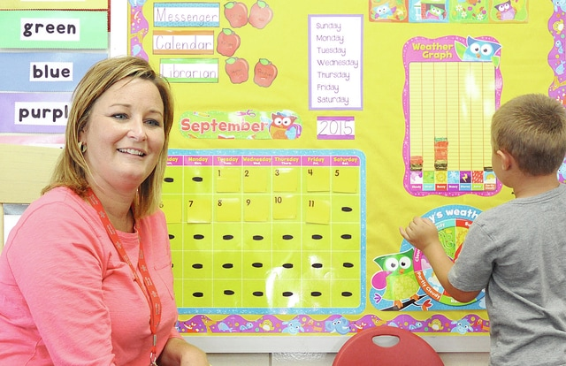 Anthony Weber | Troy Daily News Kindergarten teacher Sara Key at Hook Elementary School discusses the days of the week, the weather, and being 17 days smarter with students including calendar helper Kellan Coomer Friday at the school.