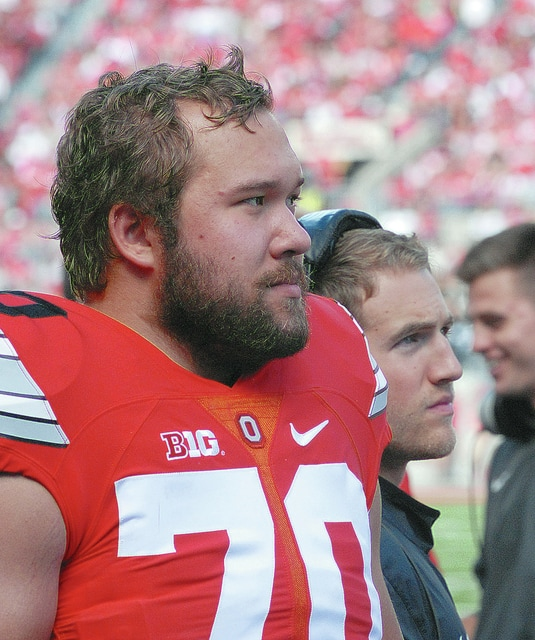 Anthony Weber | Troy Daily News Troy High School graduate Christopher Fong, a senior defensive lineman for the Ohio State football team, watches from the sidelines in OSU's 38-0 win over Hawaii Saturday