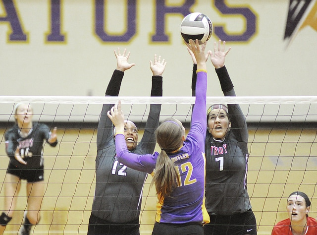 Anthony Weber/Troy Daily News Troy's Drezanee Smith (12) and Lauren Freed (7) go up for a block Tuesday at Butler.