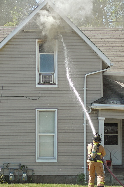 Anthony Weber | Troy Daily News Troy Fire and Troy Police departments responded to a structure fire at around 1:30 p.m. Thursday in Troy. The blaze, which occurred at 424 Madison, remains under investigation.