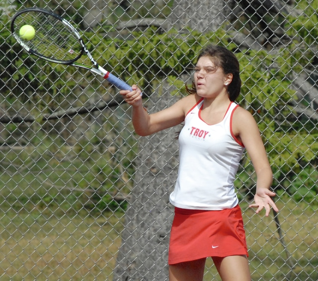 Anthony Weber/Troy Daily News Troy's Hannah Essick hits a forehand during the Division I sectional tournament Wednesday at Troy Community Park.
