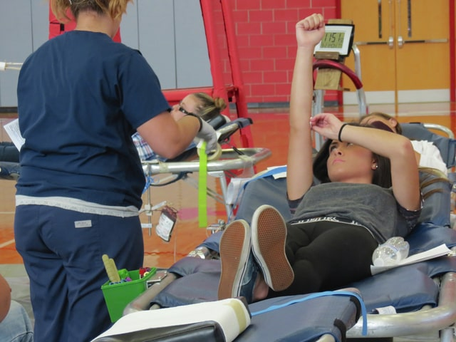 Provided photo Britney Whitlock donates blood at Troy High School.