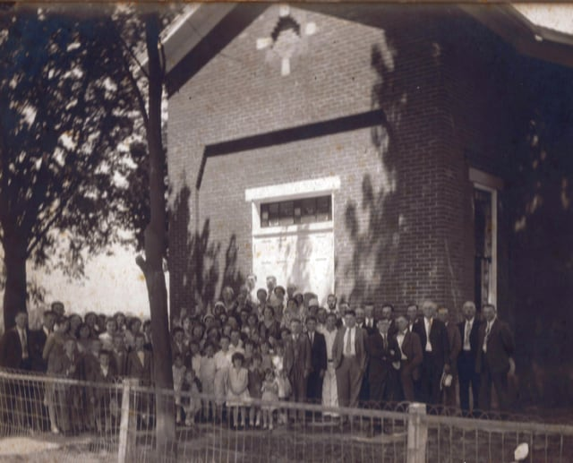 Provided photo Cove Spring Church members stand outside the church in 1931. This old church, built in 1846, burned down in 1946. Bricks salvaged from the old church were used in the walls of the current church.
