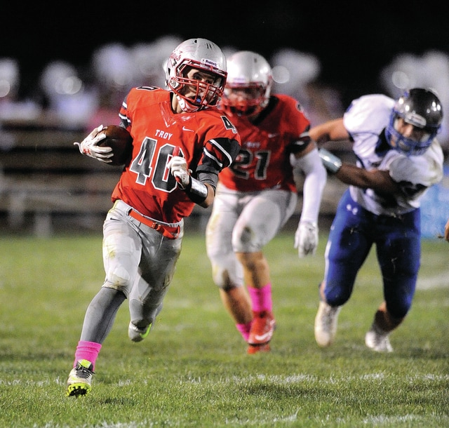 Photo courtesy Lee Woolery/Speedshot Photo Troy's Hayden Jackson brings the ball up the field against Xenia Friday.