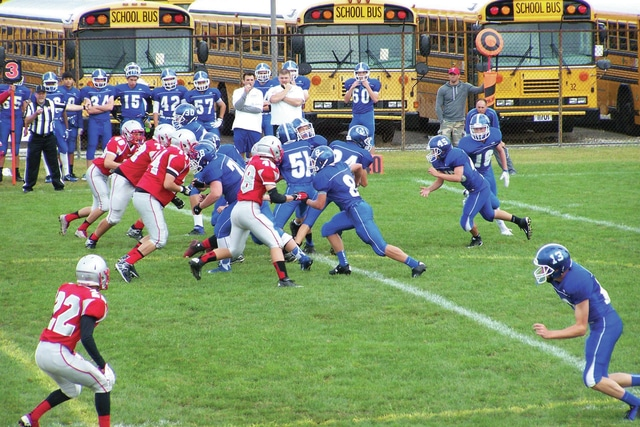 Submitted Photo The Troy freshman football team's defense battles Miamisburg.