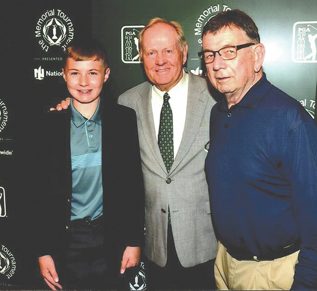 Provided Photo Former <em>Troy Daily News</em> publisher and co-owner Joel Walker (right) recently was honored as one of only two media members to have covered all 40 Memorial golf tournaments. He — along with grandson Charlie Walker (left) — got the opportunity meet with the tournament's founder, golf legend Jack Nicklaus (center).