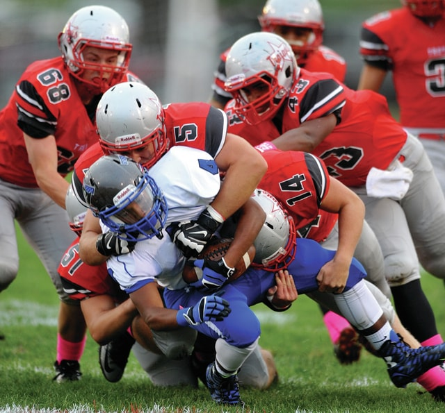 Photo Courtesy of Lee Woolery   Speedshot Photo Troy's defense wraps up a Xenia ballcarrier last Friday.