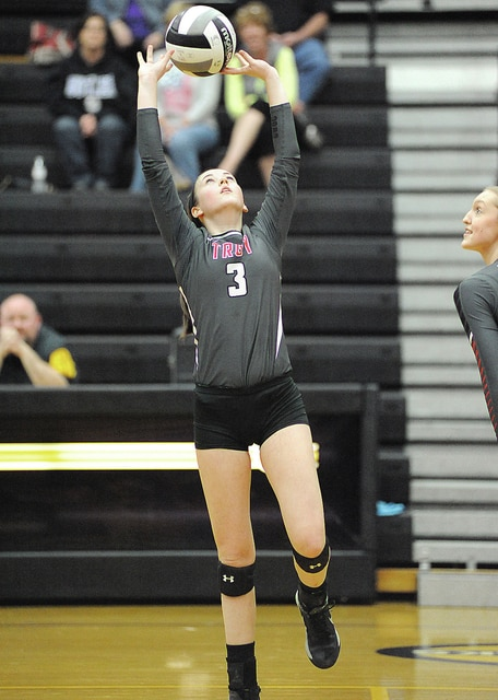 Anthony Weber/Troy Daily News Troy's Dana Wynkoop sets the ball for an attacker Saturday against Butler in the Division I sectional title match at Centerville.