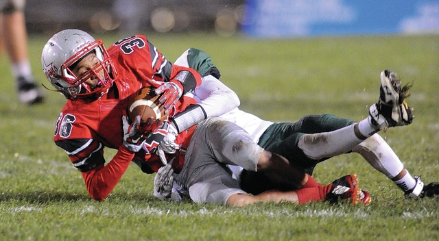 Photo Courtesy of Lee Woolery | Speedshot Photo Troy's Zion Taylor (36) is tackled following a catch Friday.
