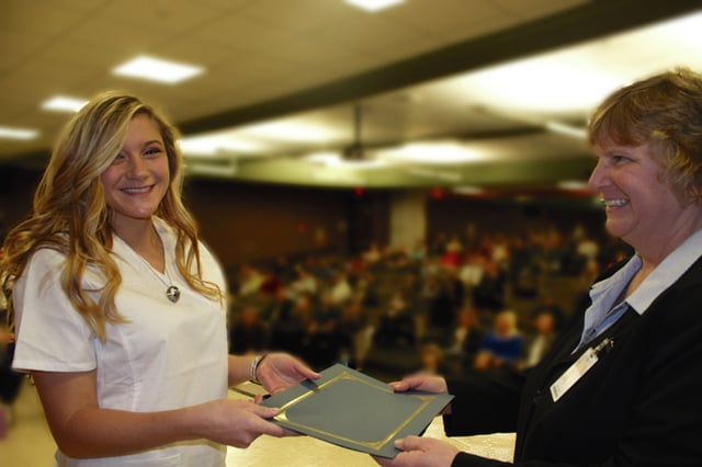 Provided photo Sarah Lewis of Piqua, left, receives Honors certificate from program sirector Lori Ludwig.