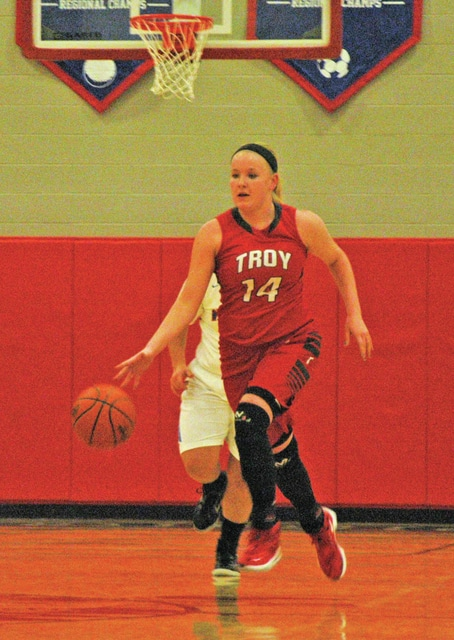 Josh Brown/Troy Daily News Troy's Kennedi Kyzer brings the ball up the floor on the fast break Friday at Northwestern. Kyzer had 20 points in Troy's 45-36 loss in the season opener.