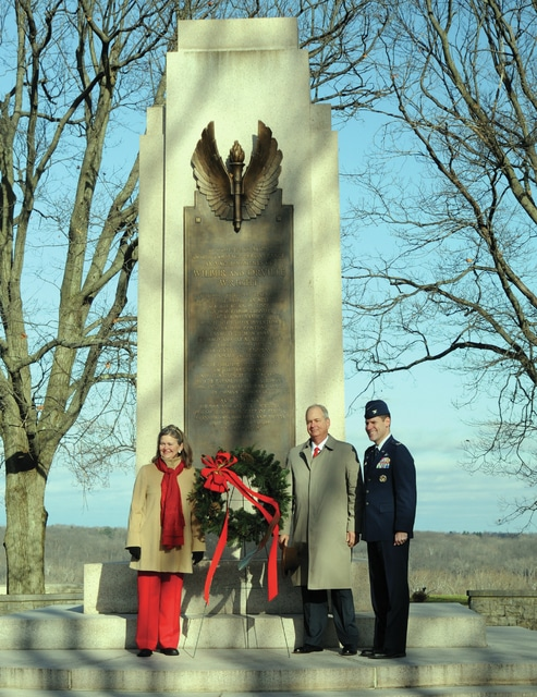 Mike Ullery | Daily Call Amanda Wright-Lane and Stephen Wright, great-grand niece and nephew of Orville and Wilber Wright, along with Col. John Devillier, commanding officer at Wright-Patterson Air Force Base, lay a wreath at the foot of the Wright monument, at Wright-Patterson Air Force Base, during ceremonies commemorating the 112th anniversary of the Wright brothers historic first-ever powered flight at Kitty Hawk, in 1903.
