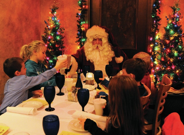 Santa Claus makes a toast, with chocolate milk, for a Merry Christmas, at LaPiazza, on the square in Troy, on Tuesday, with a group of youngsters who won a drawing for lunch with Santa. The event, sponsored by Troy Main Street allowed a dozen kids to attend, six at Basil's on Monday, and six at LaPiazza on Tuesday and the drawing was held during Troy's Grand Illumination. The lunches were served, compliments of the two restaurants. Pictured with Santa Claus are, Hannah Peoples, Luke Peoples, Allison Hewitt, Cole Bostick, and Tommy Lins. Missing from the photo is Owen Heilman.