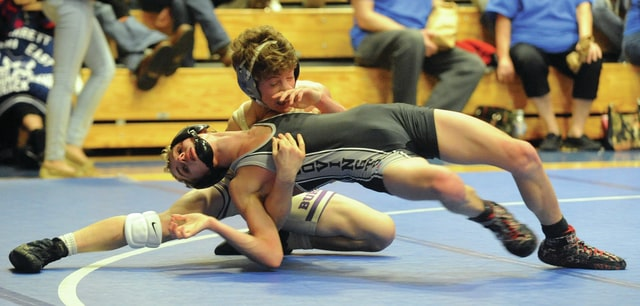 Mike Ullery | Civitas Media Covington's Connor Ryan gets a reversal against Mechanicsburg's in a 113-pound match at Miami East on Wednesday.