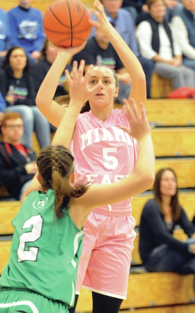 Mike Ullery | Civitas Media Miami East's Morgan Haney (5) fires a jumper over the Anna defense Saturday.