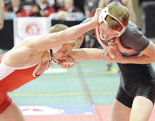 Anthony Weber/Troy Daily News file Milton-Union's Chase Mayabb (left) battles Tontogany Ostego's Buddy Limes Friday in his Division III state championship quarterfinal match at the Schottenstein Center in Columbus last season.
