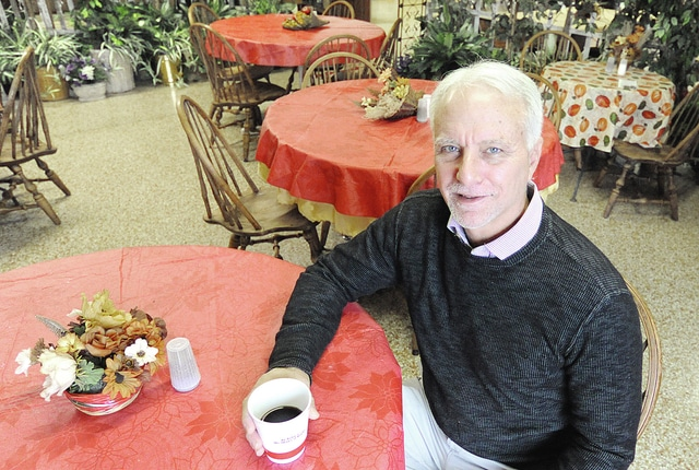 Anthony Weber | Troy Daily News CrossRoads Christian Fellowship Senior Pastor Jim Valekis sits in the ConneXion Cafe Thursday in Tipp City. CrossRoads in located at 18 East Broadway Avenue.