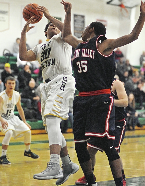 Anthony Weber/Troy Daily News Troy Christian's James Anderson works in the paint Friday against Miami Valley.