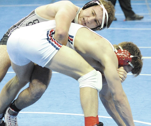 Anthony Weber | Troy Daily News Covington's Lance Miller (top) placed second at 160 pounds in the GMVWA Holiday Tournament.
