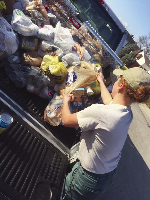 Provided photo Jen Ross, Miami County Park District operations team member, helps unload donated food items at the Depot food pantry in Bradford.