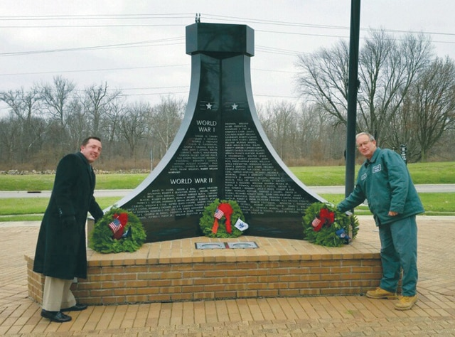 "Provided photo<style type=""text/css""></style> <p style=""margin-bottom: 0in;"">Brian Sowers, funeral director at Melcher-Sowers Funeral Home in Piqua, and Jim Roth, superintendent of Forest Hill Cemetery in Piqua, place live wreaths at the Veterans Memorial in Piqua and on the graves of veterans throughout the cemetery, honoring all veterans who have faithfully served our country. For more than 10 years, Melcher-Sowers provided the wreaths as part of the ""Wreaths Across America"" program. This week, millions of live wreaths were placed on veterans graves in local and national cemeteries across the U.S. ""We are proud to be a part of this program to honor all Veterans who have served and paid the ultimate sacrifice to preserve our country's freedom,"" Sowers said."