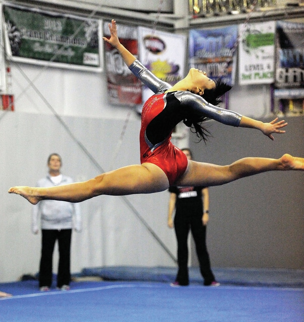 Photo courtesy Lee Woolery/Speedshot Photo Troy's Minori Nakada competes on the floor during Monday's Troy Invitational at Gem City Gymnastics. Nakada was first overall, helping the Trojans win the meet as a team.