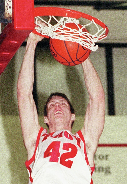 Rick Ramsey | Troy Daily News Matt Terwilliger — who scored 1,156-career points at Troy — throws down a dunk in this 2004 file photo.