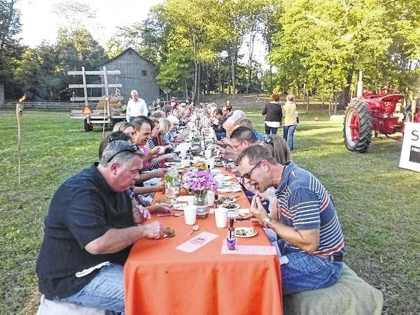 Diners enjoy a locavore dinner Sept. 17, 2015, at Staley Mill Farm in Miami County. The dinner was among events sponsored by the Miami County Local Food Council, a group of farmers and community organizers dedicated to bringing healthy, affordable, and sustainably grown local foods to this northern Miami Valley community.