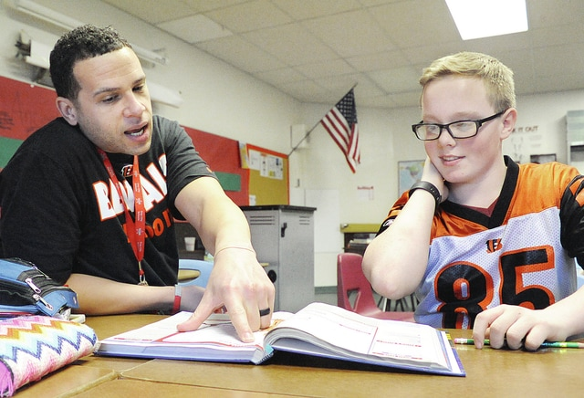 Anthony Weber | Troy Daily News Van Cleve Sixth Grade Building teacher Jeremy Hughes assists Jordan Wolford with a lesson on ancient Egypt Friday at the school in Troy.