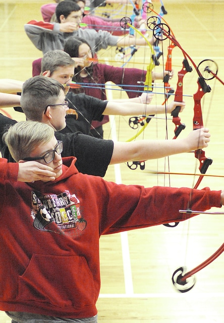 Anthony Weber | Troy Daily News Eighth grade students at Troy Junior High School practice shooting at 10 and 15 meters during archery practice at the school recently.