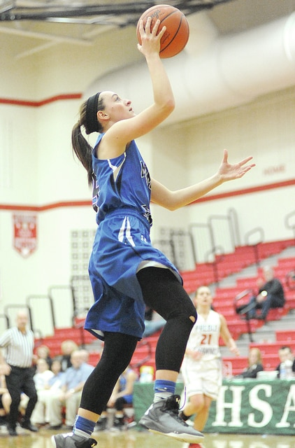 Anthony Weber/Troy Daily News Miami East's Morgan Haney goes in for a layup Saturday against Preble Shawnee at Tippecanoe High School.