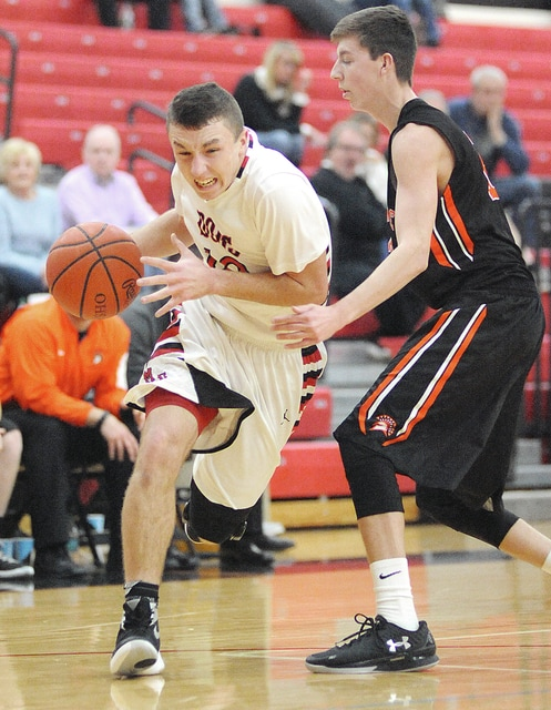 Anthony Weber/Troy Daily News Milton-Union's Joey Swafford drives past a Waynesville defender Thursday.